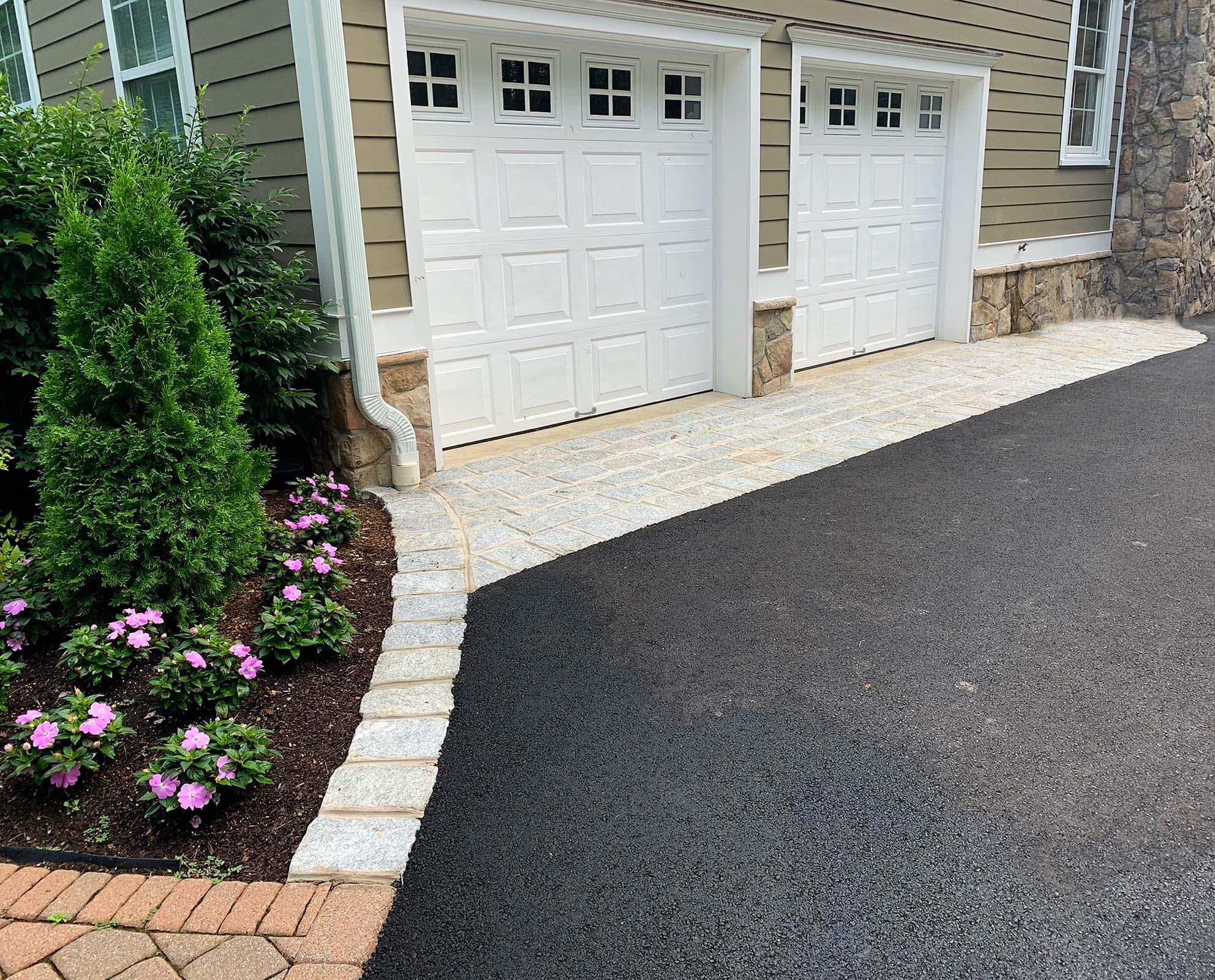 Paved driveway with curb detailing